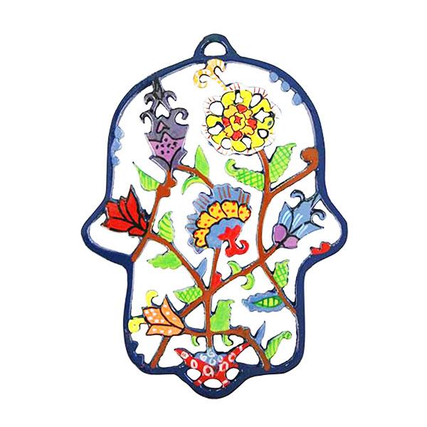 """מתלה חמסה מרשימה ( 16*13 ס""""מ ) ממתכת בחיתוך לייזר צבועה ביד """"פרחים"""" - יאיר עמנואל. בחמסה זו מופיעים פרחי ארץ ישראל, כפי שרואה אותה האומן עמנואל בעיני רוחו. החמסה עשויה מתכת בחיתוך לייזר ומצוירת בצבעי אקריליק בציור יד. מחירי מבצע מיוחדים אתר מתנות ישראל"""