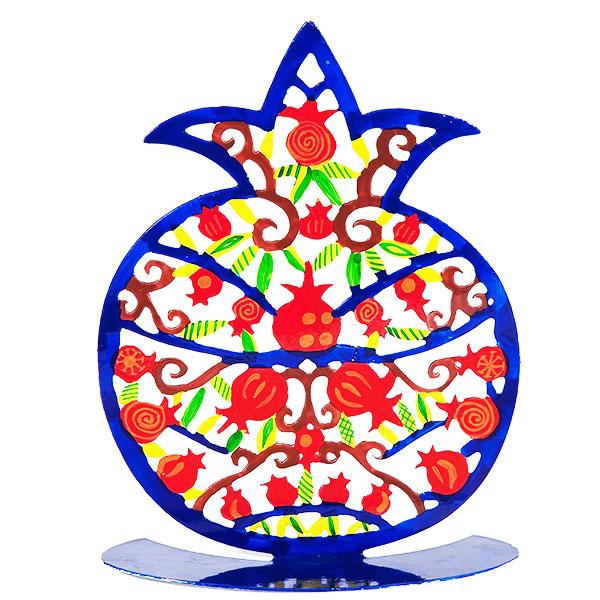 """סטנד רימון """"רימונים"""" מרשים ( 20 * 16 ס""""מ ) ממתכת בחיתוך לייזר צבועה ביד בצבע כחול. חיתוך מדויק של רימונים- מעוצב ומיוצר ע""""י יאיר עמנואל. החמסה עשויה מתכת בחיתוך לייזר וממצוירת בצבעי אקריליק בציור יד. מחירי מבצע מיוחדים באתר מתנות ישראל"""