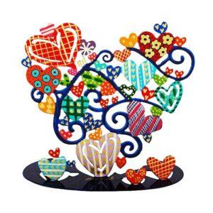 סטנד מגזרת בצורת לב ( 18.5 * 19.5 * 10 ) ממתכת בחיתוך לייזר של שלל לבבות צבעוניים - מהמם. ציור בעבודת.יד פריט ייחודי ומרהיב להנחה על השולחן, מדף, דלפק שמגיע ובצבעים שונים ומושך את תשומת הלב. מוצר זה הינו מתנה נהדרת לקישוט מושלם לבית/עסק. מעוצב ומיוצר ע