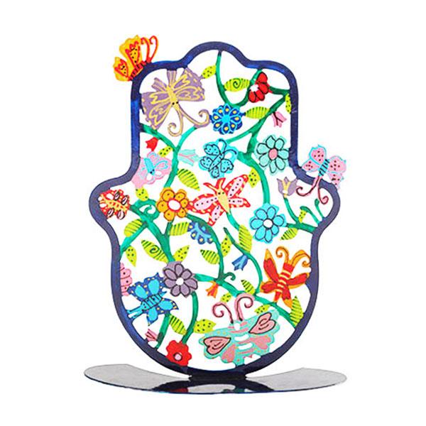 """סטנד חמסה מרשימה ( 15 * 11 * 15 ס""""מ ) ממתכת בחיתוך לייזר צבועה ביד """"פרחים ופרפרים"""" - יאיר עמנואל. בחמסה זו מופיעים פרחי ופרפרי ארץ ישראל, כפי שרואה אותה האומן עמנואל בעיני רוחו. החמסה עשויה מתכת בחיתוך לייזר ומצוירת בצבעי אקריליק בציור יד. מחירי מבצע מיוחדים אתר מתנות ישראל"""