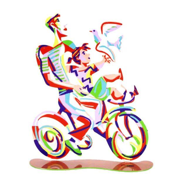 """סטנד """"רכיבת סוף שבוע"""" Weekend Ride ( Height- 36cm Width-29cm   Weight: 0.95KG – סטנד מתכת צבעוני בעבודת יד עם הדפס דו צדדי על מתכת בחיתוך לייזר. צבעוני. סטנד מהמם בצורת מדגים את האב והבת המקסימים בטיול האופניים שלהם בסוף השבוע. נסיעה אביבית כובשת עם ציפורים זו לוכדת את מהות יצירתו של דייוויד גרשטיין. שמחת חיים, צבעוניות אופניים ורומנטיקה מעוצב ומיוצר ע""""י האמן דוד גרשטיין. פסל מתכת מקסים זה להנחה על השולחן מדף מאת דייוויד גרשטיין, החוקר את אחד הנושאים החביבים עליו ביותר, רכיבה על אופניים. מחיר מבצע מתנות ישראל"""