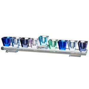 המתנה המושלמת לחנוכה! חנוכייה מעוצבת עם קנים בצבעים שונים בגוונים כחולים! חנוכייה העשויה מקריסטל איכותי. חנוכייה מהודרת באיכות גימור מעולים ומחיר מבצע מיוחד! גודל: 27X5 ס